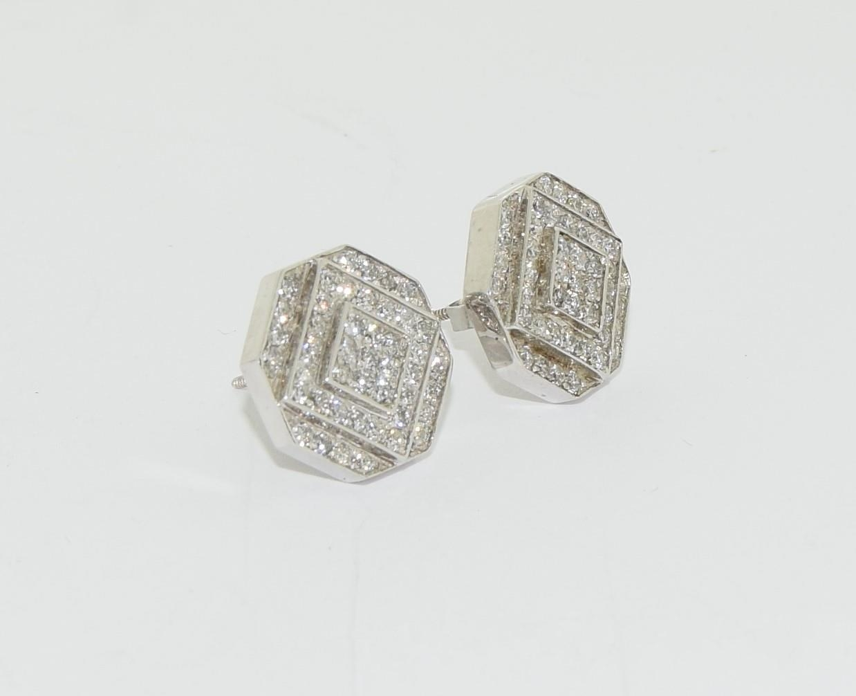 Pair of 14ct white gold cluster diamond earrings of approx 1ct