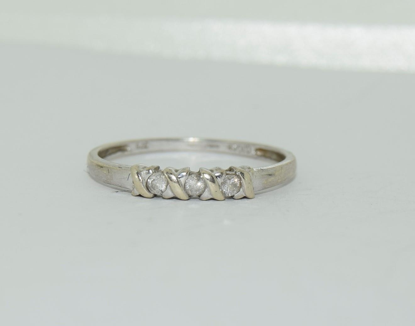 9ct white gold diamond 3 stone ring h/m for 0.1ct size Q - Image 11 of 12