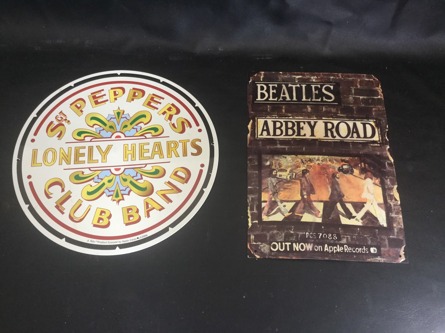 2 X METAL BEATLE PLAQUES. The first is advertising the Abbey Road album on Apple Records which