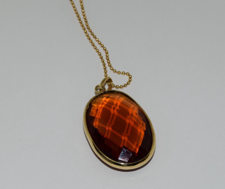 Gold amber quartz pendant necklace.