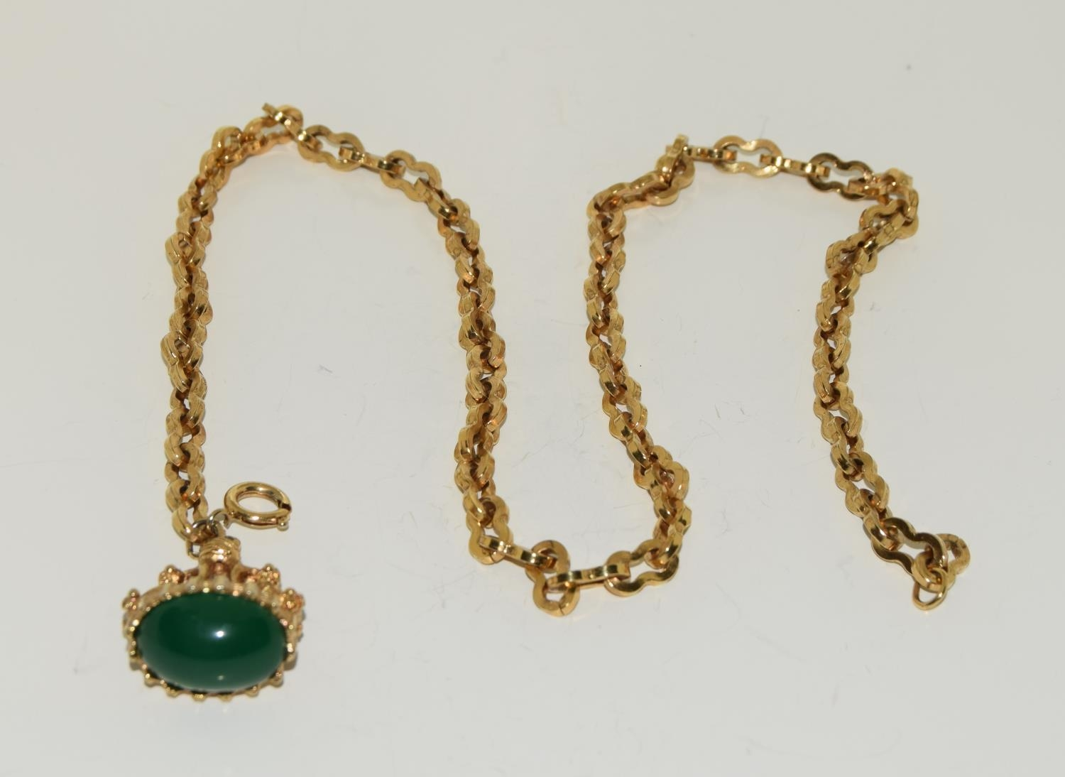 Gilded watch chain and fob set with a cabochon jade stone