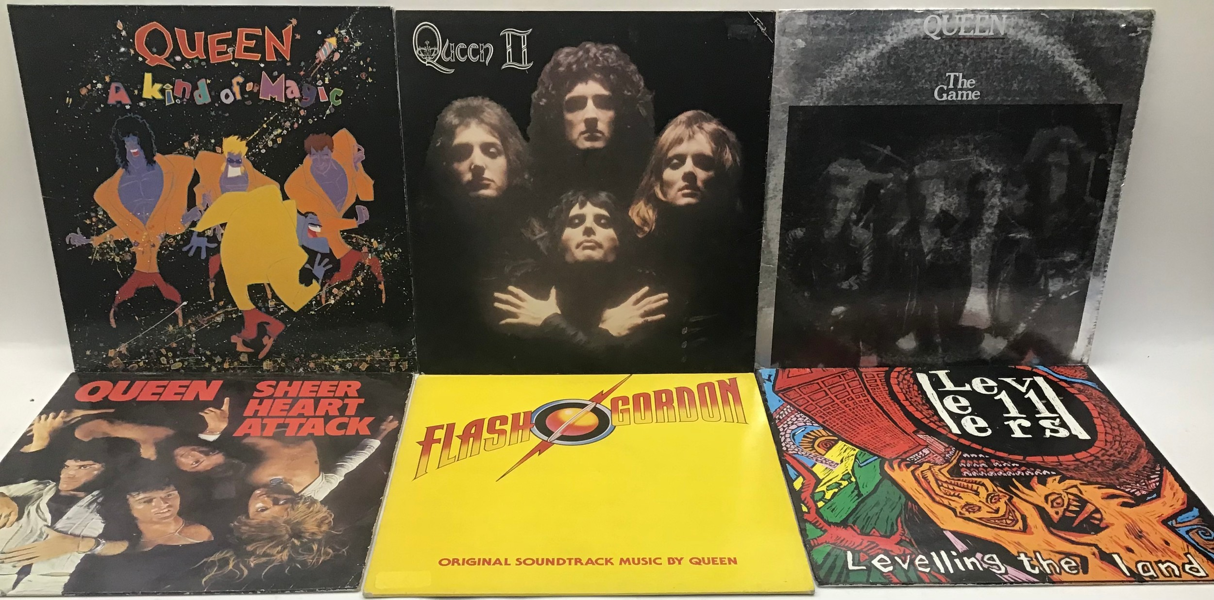Box containing various 80?s and 90?s rock / pop albums to include Queen x 5 Joy Division x 2 - The