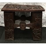 A dark wood possibly Indonesian carved occasional table 51x36x39cm.