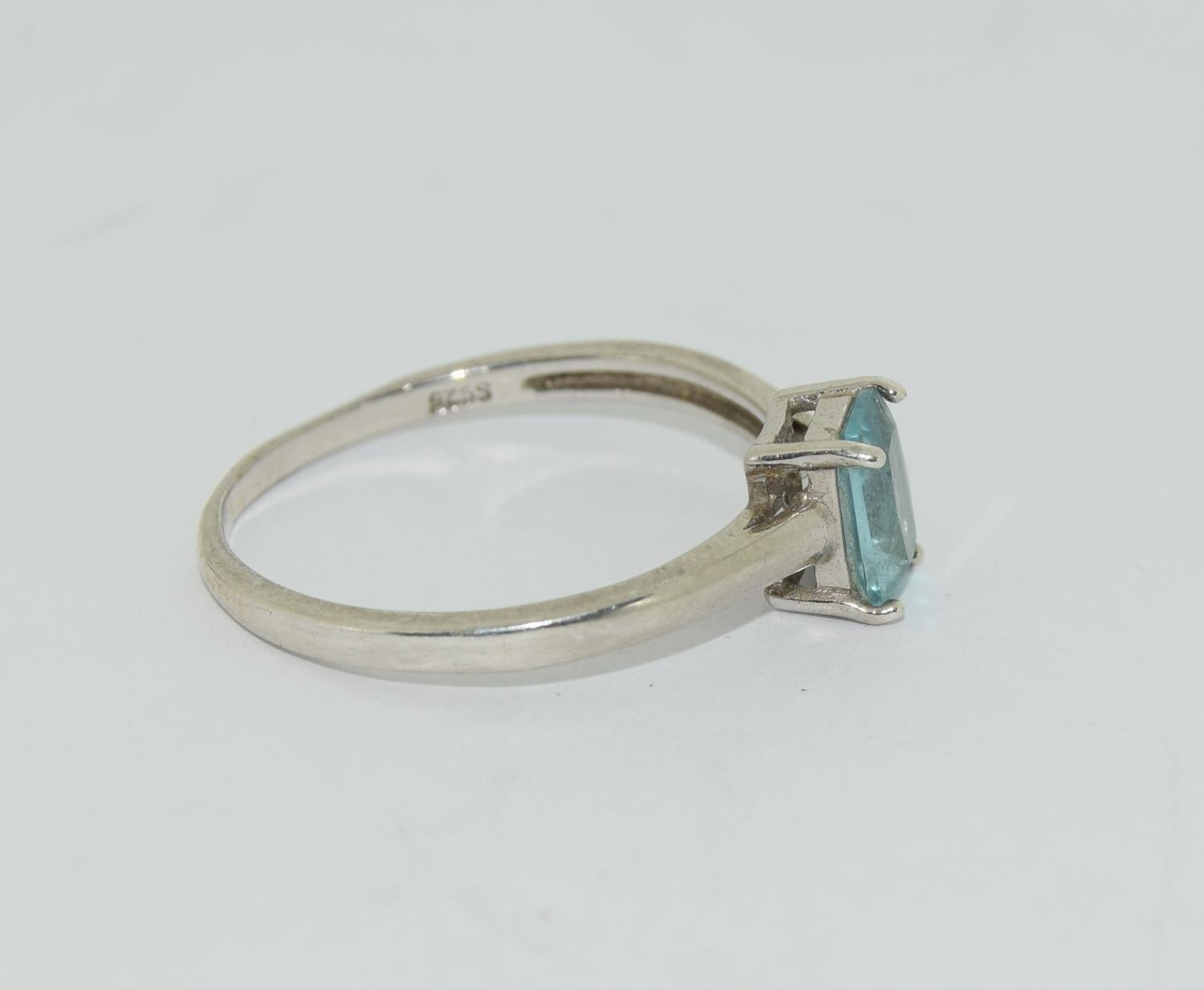 A 925 silver and blue topaz ring. Size R - Image 2 of 3