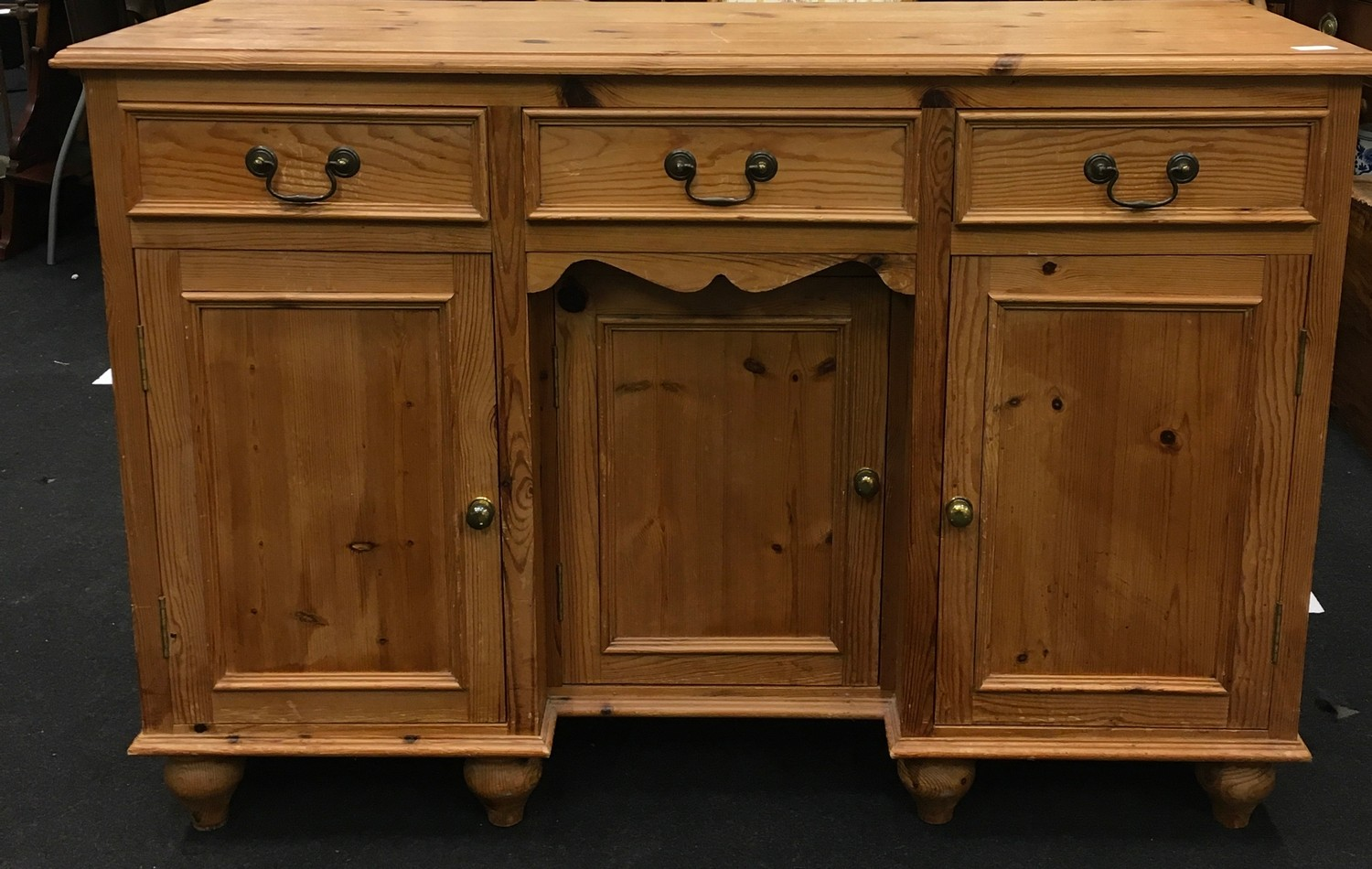 Pine 3 draw over 3 door side board with brass handles and turned feet 85x125x45cm