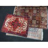 Three patterned wool carpets.