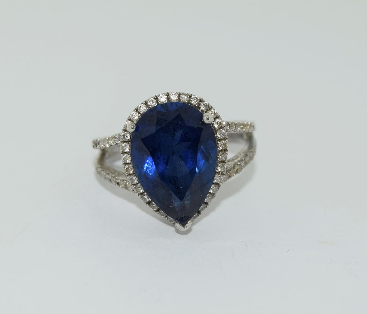 Silver ladies blue stone pear shape ring. Size K.