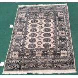 "Modern machine made beige carpet. 76x50"""