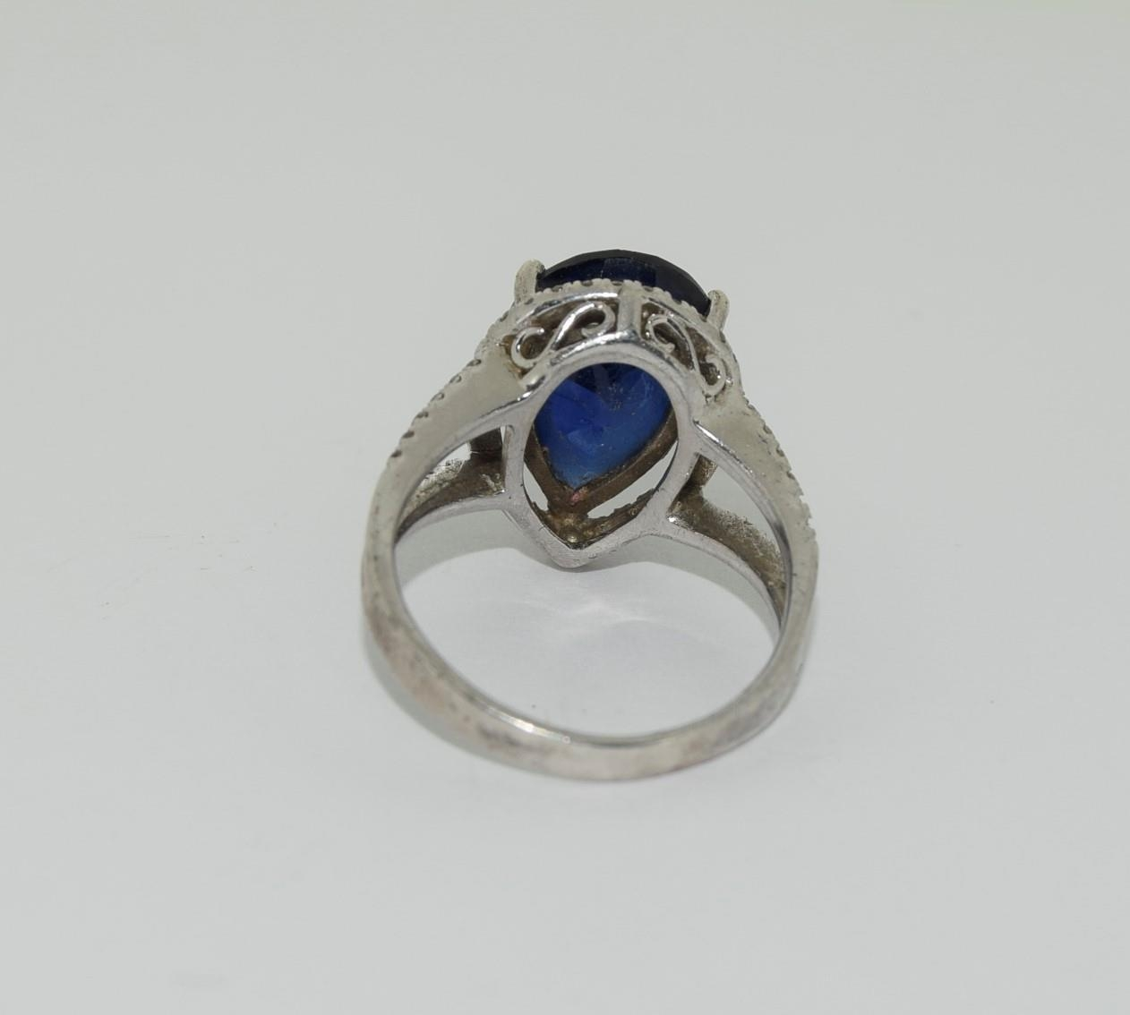 Silver ladies blue stone pear shape ring. Size K. - Image 3 of 3