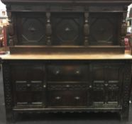 Oak 2 draw 2 door carved buffet complete with back panel and turned supports 170x180x65cm