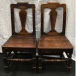 A pair of antique oak Georgian country chairs each 95x47x42cm.