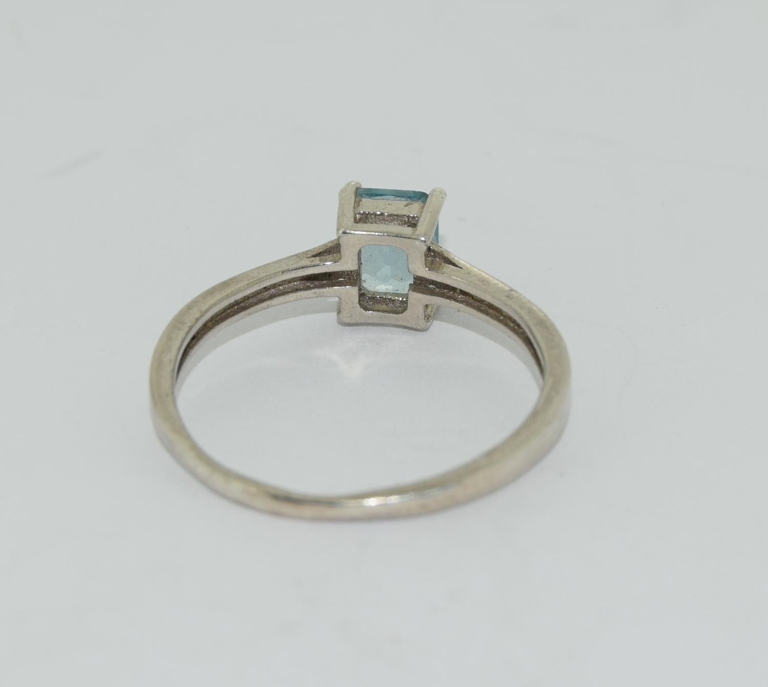 A 925 silver and blue topaz ring. Size R - Image 3 of 3