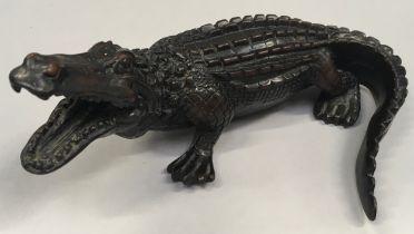 A carved ornate Indian wood crocodile.