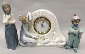 """Lladro """"6259"""" Pierrot Rehearsing together with Lladro """"5777"""" Swan Clock and Nao girl figure (3)."""