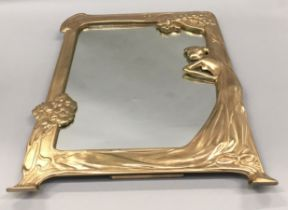 A silver plated Art Nouveau style easel backed mirror.
