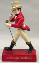A pottery Johnny Walker advertising figure 1940's.
