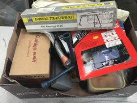 Box of various car accessories.
