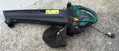 A portable leaf blower/vacuum with attached bag.