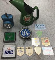 Original Castrol oil jug along with various badges and vintage bike light.