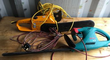 """A 14"""" McCulloch electric chainsaw & a Bosch hedge trimmer."""