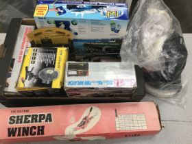 Box of car accessories to include tyre inflater, car washing kit, Sherpa Winch and other items.