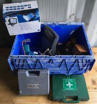 A blue crate containing caravan battery charger, hot air blow torch, security light, sander and