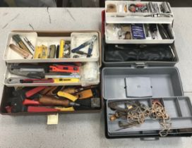 3 plastic tool boxes with various tools.