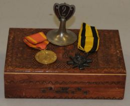 Polish WWII medal and an 1896 Ashanti Star in a carved wooden box