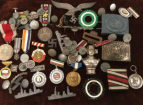 A box of German badges etc.