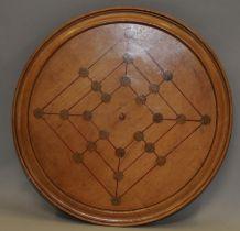 Vintage round wooden breadboard with inlaid Twelve Mans Morris game
