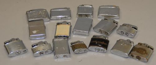 A box of lighters including Zippo and Ronson