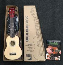 A new Pure Tone ukulele musical instrument.