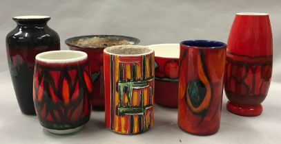 Poole Pottery to include Delphis vases and studio piece (7).