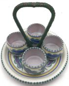 Poole Pottery FK pattern egg cup set with wicker/metal handle.