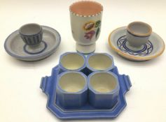 Poole Pottery Carter Stabler Adams unusual egg cup set on tray together with three other eggcups.