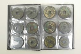 """A wallet of Chinese facsimile (replica) bronze coinage, 1½"""" diameter"""