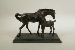 """A 'crosa' bronzed composition figure group of a horse and foal, 10½"""" long"""
