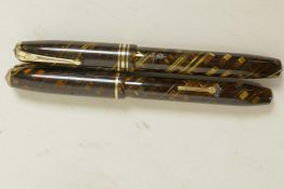 A vintage 'Relief' tiger's eye fountain pen, no.12, with 14ct gold nib and a vintage Conway