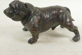 """A cast bronze figure of a bulldog, 7½"""" long"""