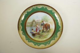 A Vienna porcelain charger, decorated with a hand finished transfer print depicting two women