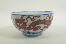 A Chinese blue and white porcelain bowl of lobed form, decorated with iron red dragons to exterior