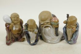 """Four Chinese, Shiwan style, mud men shaven head pilgrim figures, 4½"""" high"""