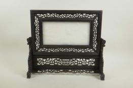 """A Chinese carved white jade and hardwood table screen with carp and lotus flower decoration, 15"""" x"""