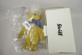 """A Steiff 1909 replica teddy bear with growler and blue bow, 13"""" tall, in original box and packaging"""