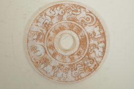"""A Chinese hardstone pi disc with moulded Zodiac animal and character inscriptions, 8"""" diameter"""