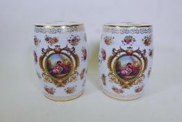 A pair of porcelain garden stools decorated in the European manner with flowers and panels of