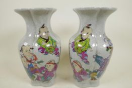 """A pair of Chinese crackleware vases decorated with children, seal mark to base, 9"""" high"""