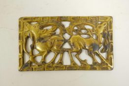 """An Ordos bronze plaque with pierced goat decoration and a gilt patina, 5"""" x 3"""""""
