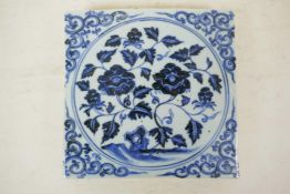 """A Chinese blue and white porcelain temple tile, with floral decoration, 8"""" x 8"""""""