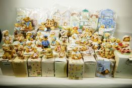A collection of 37 'Cherished Teddies' figures with certificates and boxes plus village